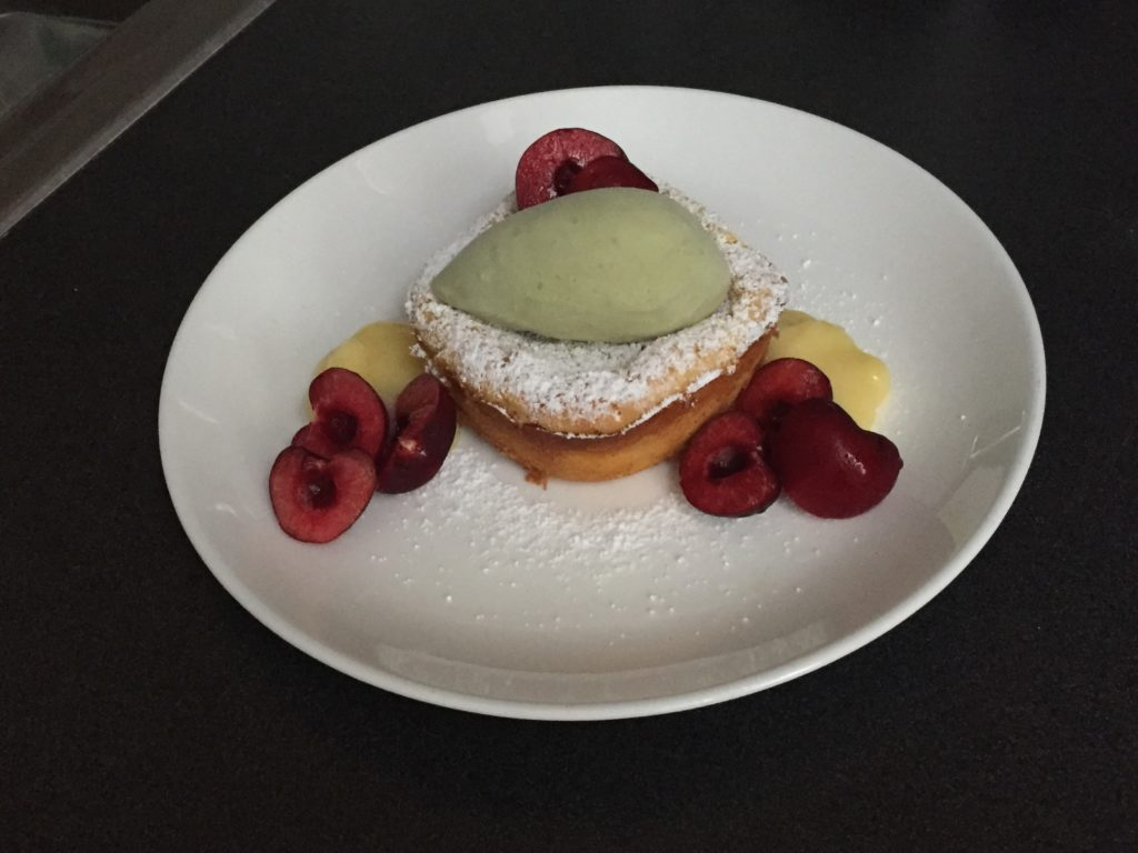 Molten Cheesecake, Green Tea Ice Cream, Lemon Curd and Fresh Cherries plated dessert pastry